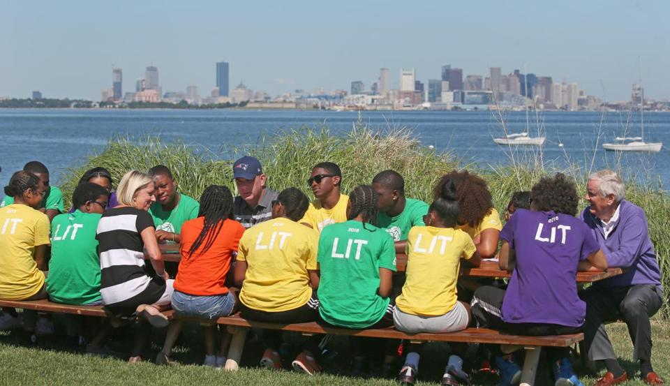 "BOSTON, MA - 7/12/2018: Mayor Marty Walsh is visiting Camp Harbor View on Long Island to teach a civics class to a group of 15 to 18-year-olds who have been deemed ""Leaders in Training."" Seated on bench, in striped dress blonde is Lisa Fortenberry, the Executive Director Camp Harbor View and in purple far right on bench is Jack Connors Jr founder Camp Harbor View. (David L Ryan/Globe Staff ) SECTION: METRO TOPIC 13camppic"